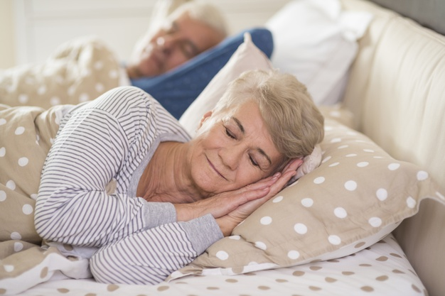 woman-her-husband-sleeping-comfortably_329181-7761